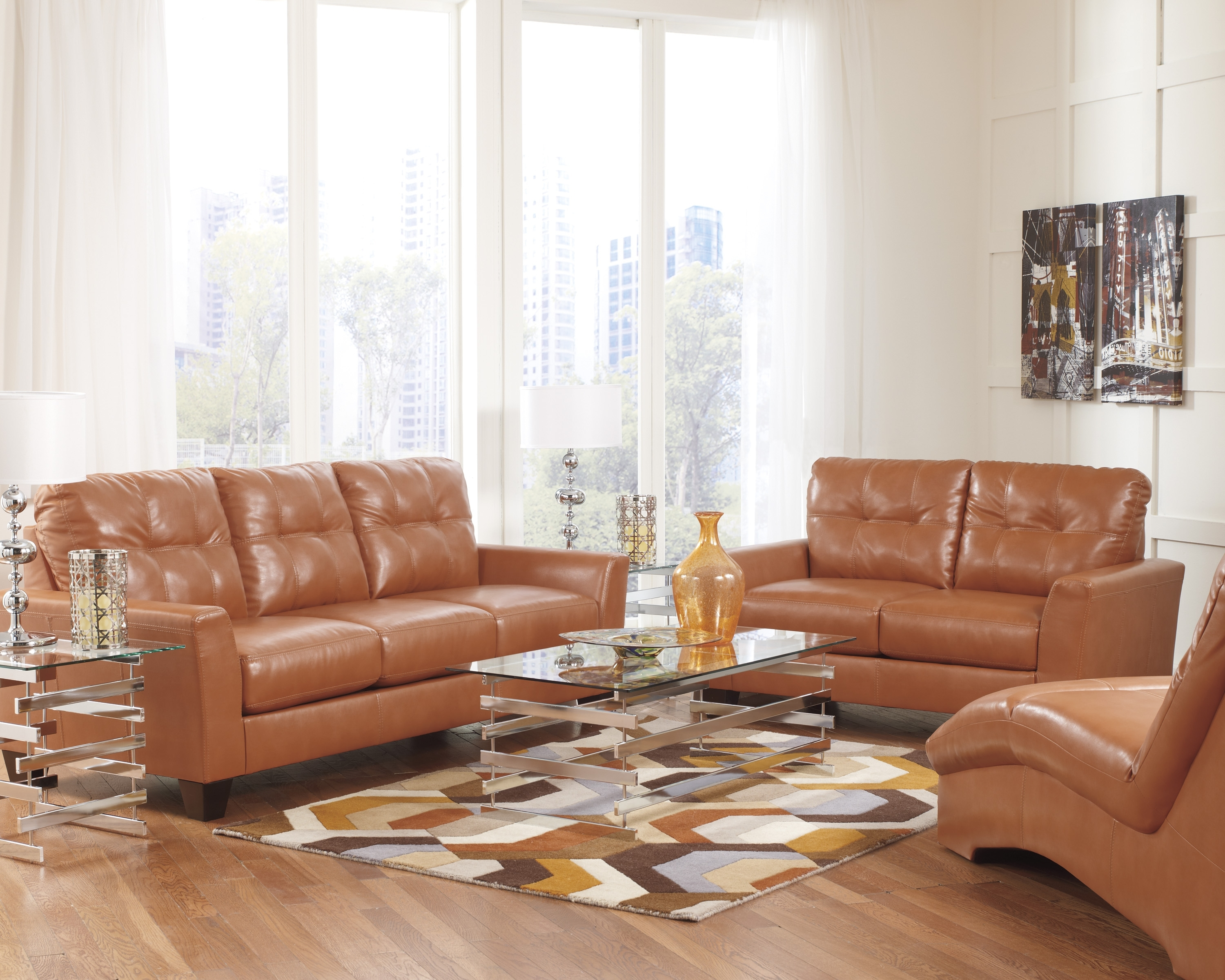 Current Ashley Tufted Sofas With Paulie Durablend Leather Orange Sofa Collection (View 9 of 15)