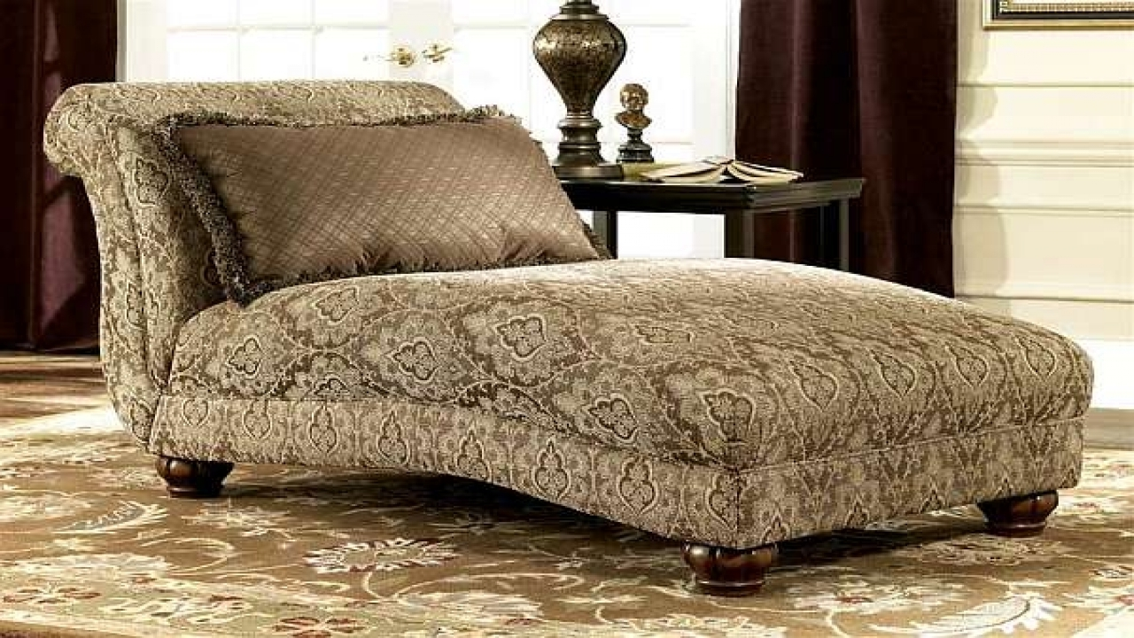 Ornate Brown Fabric Double Chaise Chair With Round Wooden Legs Of With Well Known Round Chaise Lounges (View 12 of 15)