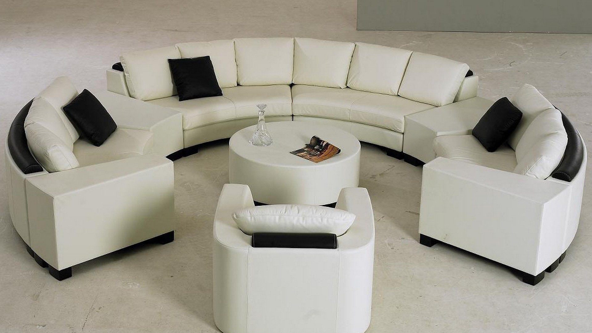 Popular Round Sofas Pertaining To Engagng White Half Round Sofa With Black Pillows And Rond Table (View 6 of 15)