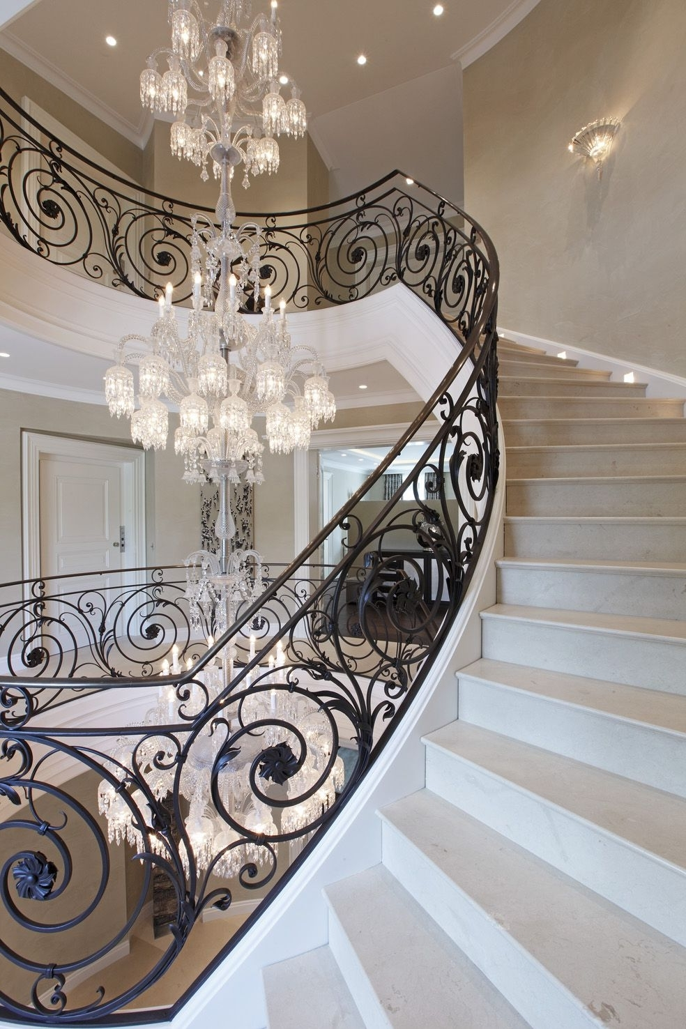 Baccarat Chandelier Villa Privéestunning Wrought Iron Stair With Well Liked Stairway Chandelier (View 1 of 15)