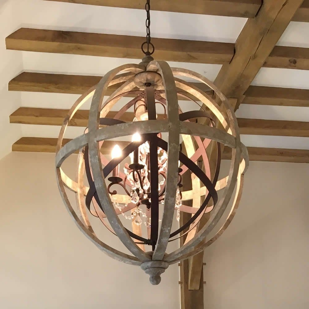 Large Round Wooden Orb Chandelier With Metal Orb Detail And Crystal Within Newest Orb Chandeliers (View 9 of 15)