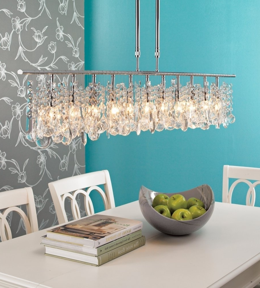 Turquoise Bedroom Chandeliers Pertaining To Most Current Hanging Low Modern Crystal Linear Chandelier Above Solid Wooden (View 10 of 15)