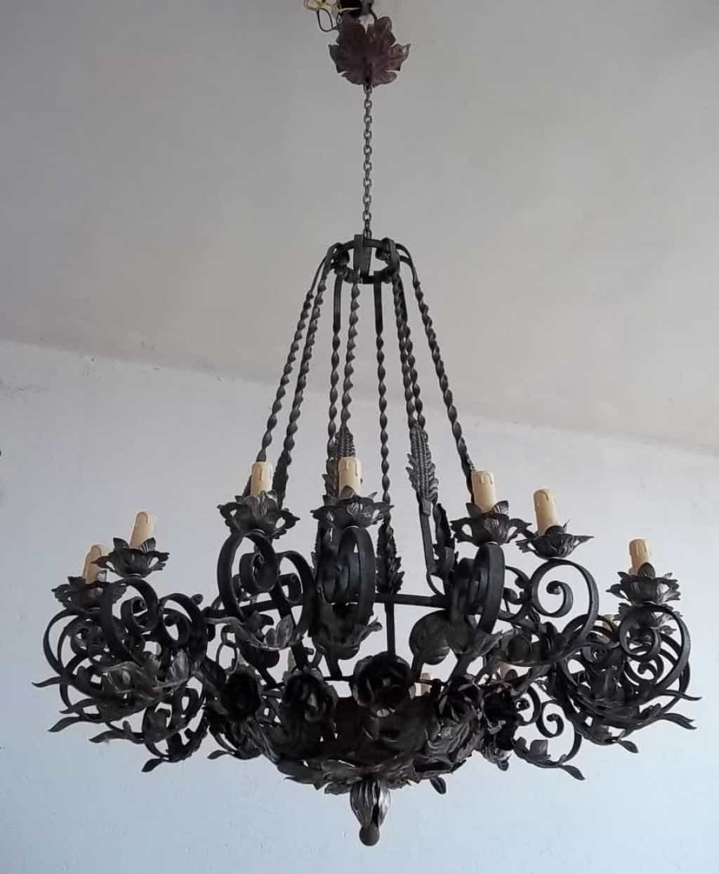 Wrought Iron Chandelier With Most Current Black Vintage Wrought Iron Chandelier Hung In The White Ceiling (View 12 of 15)