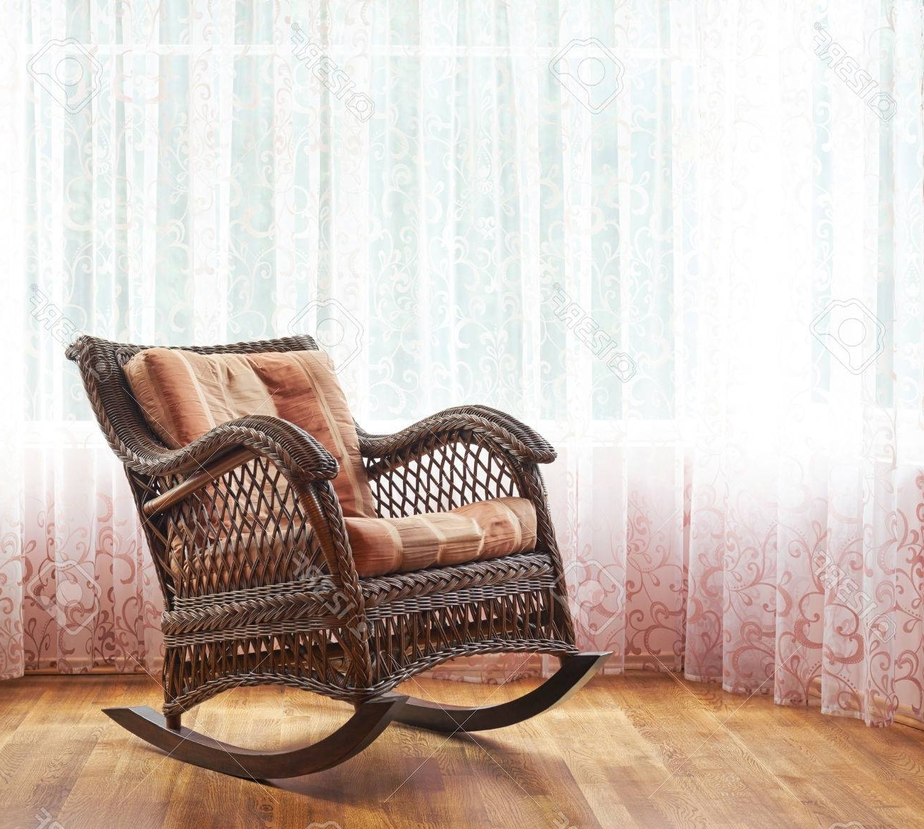 2017 Indoor Wicker Rocking Chairs For Brown Wicker Rocking Chair Against The Window's Curtains, Indoor (View 1 of 15)