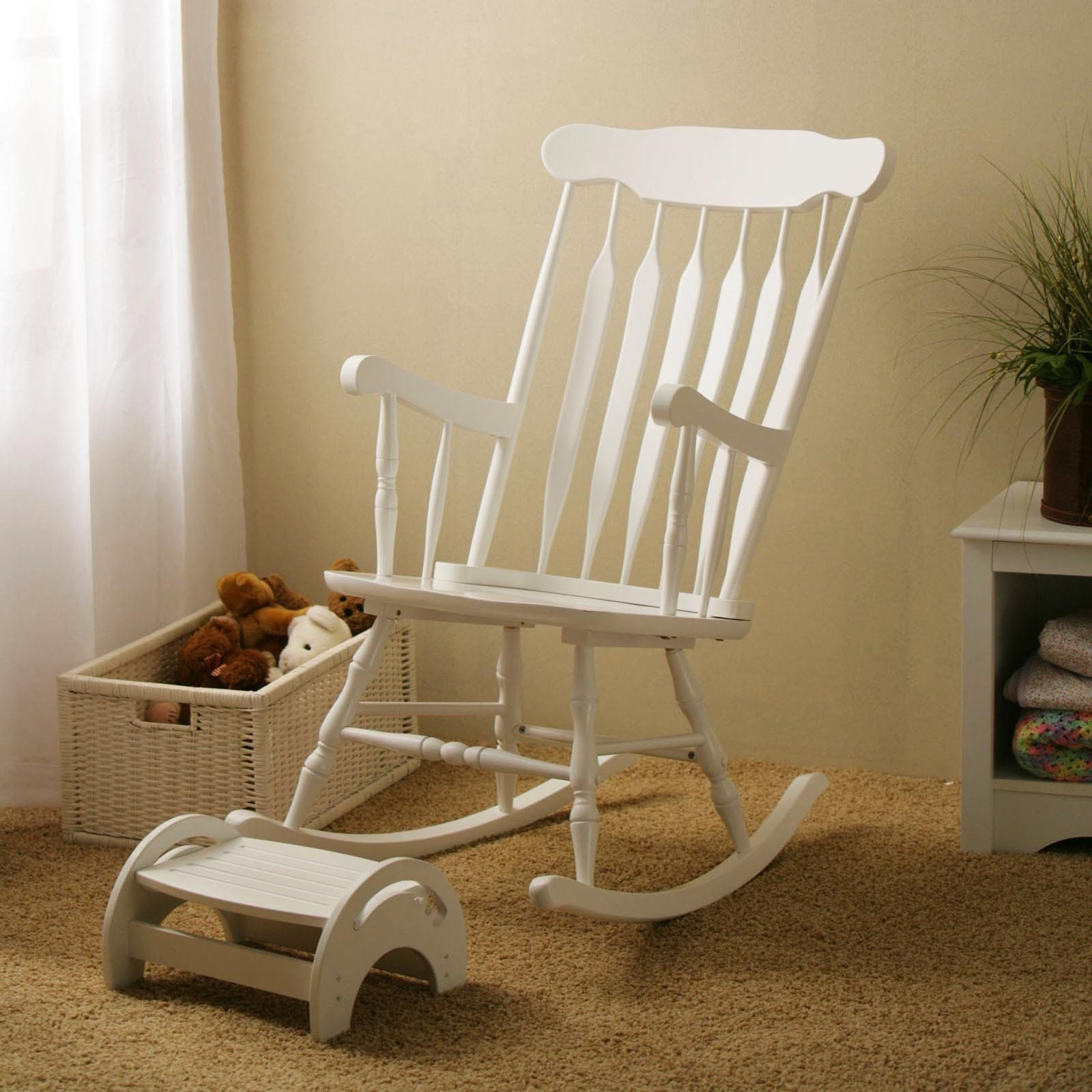 Fashionable Rocking A Newborn Baby To Sleep In A Comfy Nursery Chair Is A Great Throughout White Wicker Rocking Chair For Nursery (View 4 of 15)