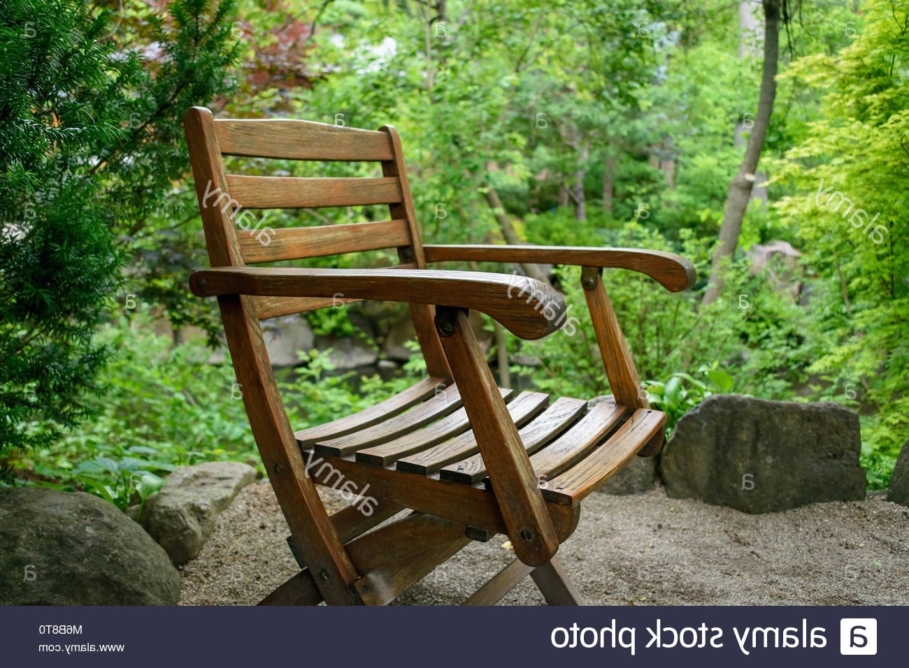 Recent Weathered Wood Chair Sitting Outside In Japanese Zen Garden Stock Throughout Zen Rocking Chairs (View 9 of 15)