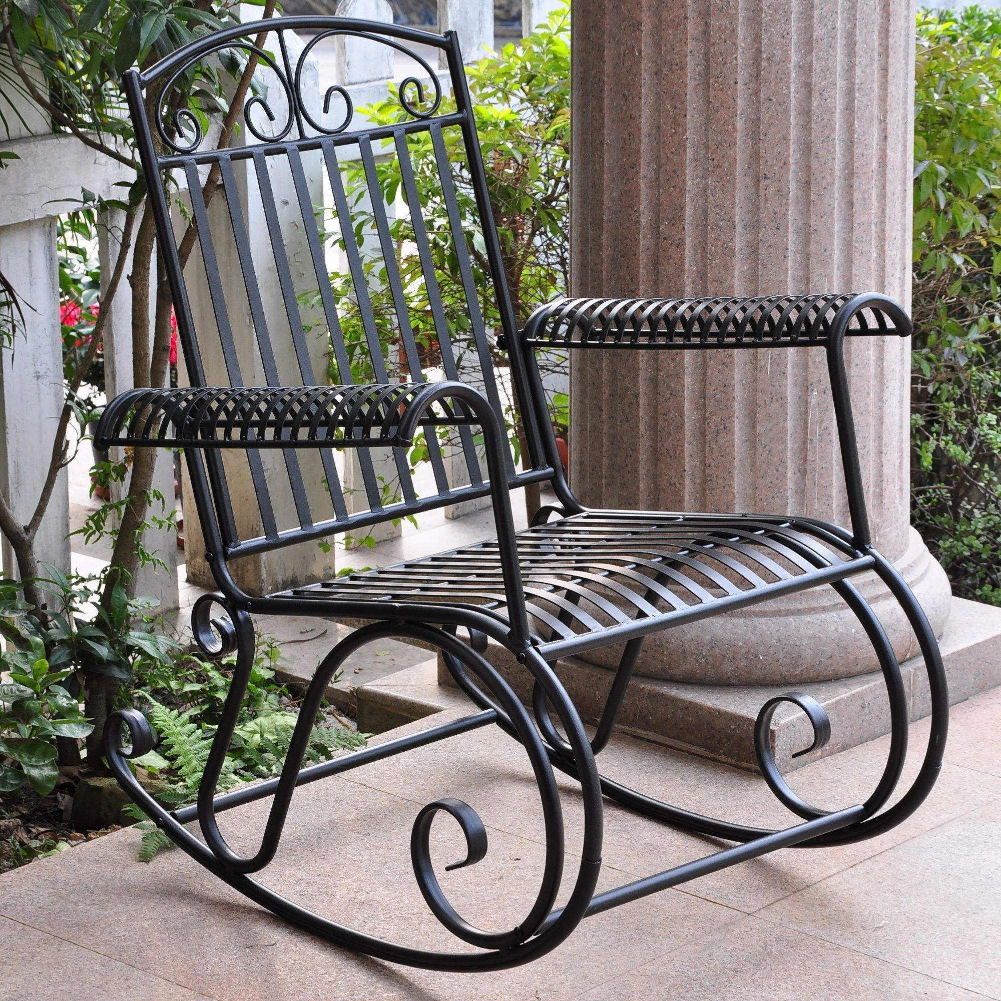 Trendy Wrought Iron Patio Rocking Chairs With Wrought Iron Chairs With Upholstered Cushions At An Outdoor Seating (View 7 of 15)
