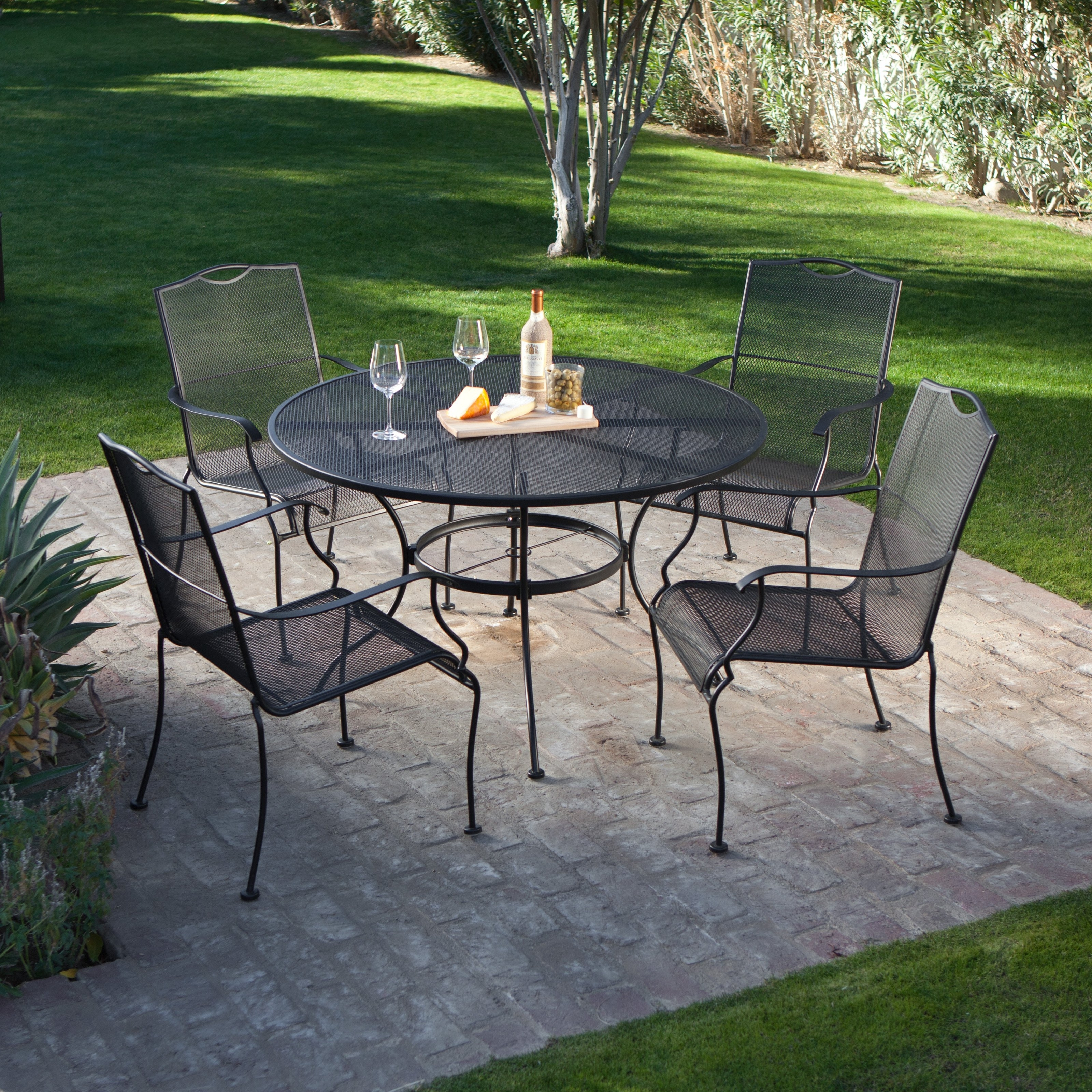 Wrought Iron Patio Conversation Sets Inside Most Current Woodard Stanton Wrought Iron Dining Set Video (View 12 of 15)