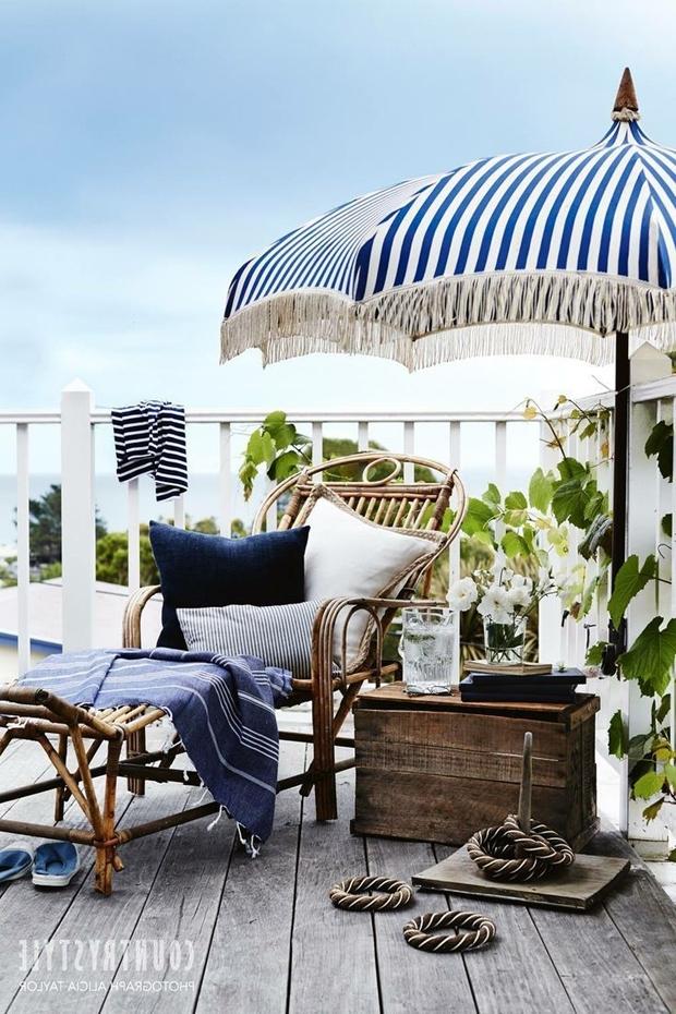 Favorite Keep Your Cool: 7 Stylish Patio Umbrellas Within Drape Patio Umbrellas (View 9 of 15)