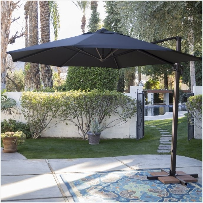 Giant Patio Umbrellas Reviews » Elysee Magazine Inside Current Patio Umbrellas With Wheels (View 10 of 15)