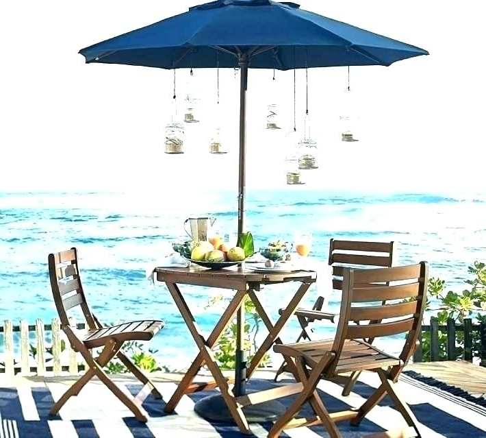 Patio Tables With Umbrella Hole Inside 2018 Patio Furniture With Umbrella Leaders In Outdoor Comfort And Value (View 11 of 15)