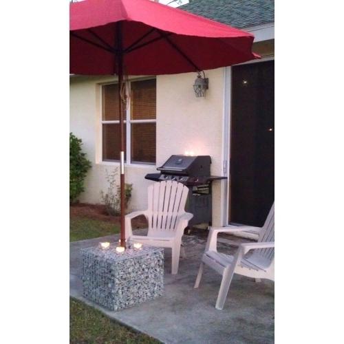 Patio Umbrellas And Bases With Regard To Preferred Gabion Basket Patio Umbrella Base Cover (View 10 of 15)