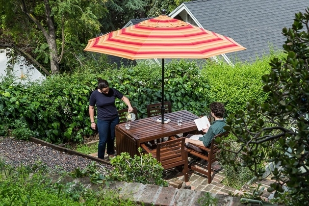 Recent Striped Sunbrella Patio Umbrellas Throughout The Best Patio Umbrella And Stand: Reviewswirecutter (View 8 of 15)