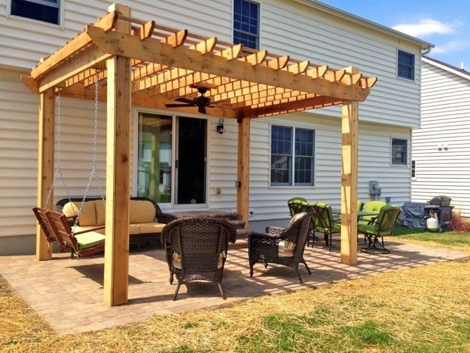 Most Recently Released Pergola With A Ceiling Fan And Porch Swing (View 5 of 15)