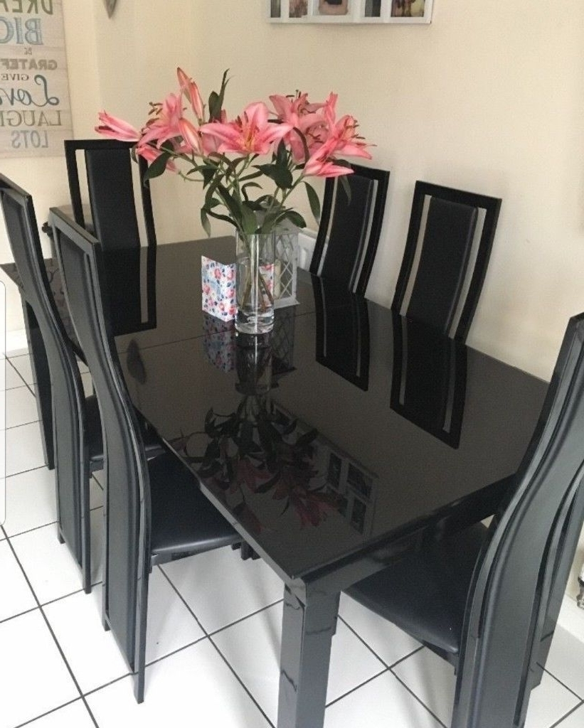 2018 Dining Tables Black Glass throughout Harvey's Brand New, Noir Extending Black Glass Dining Table.