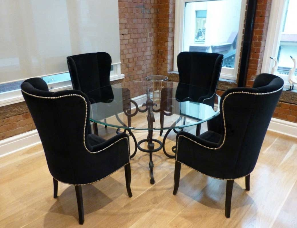 Awesome Black Wing Back Dining Chair With Round Glass Dining Table Within Newest Wyatt 7 Piece Dining Sets With Celler Teal Chairs (Gallery 4 of 25)
