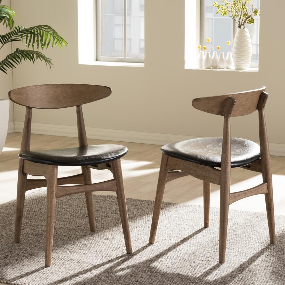Baxton Studio Flora Black Faux Leather And Medium Brown Wood Dining For Most Recent Dining Chairs (View 15 of 25)