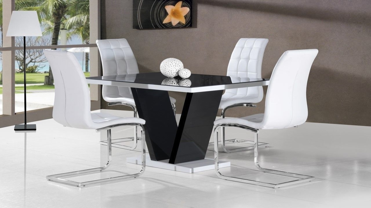 Black Glass High Gloss Dining Table And 4 White Chairs Homegenies Throughout Most Recent Black Gloss Dining Room Furniture (Gallery 18 of 25)