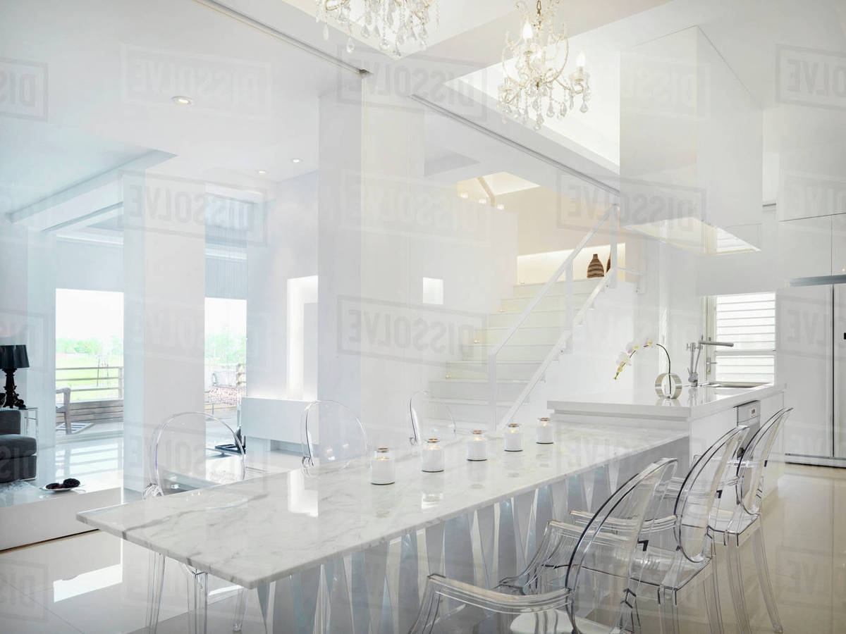 Clear Plastic Dining Tables Regarding Most Up To Date Marble Dining Table With Clear Plastic Chairs – Stock Photo – Dissolve (View 7 of 25)