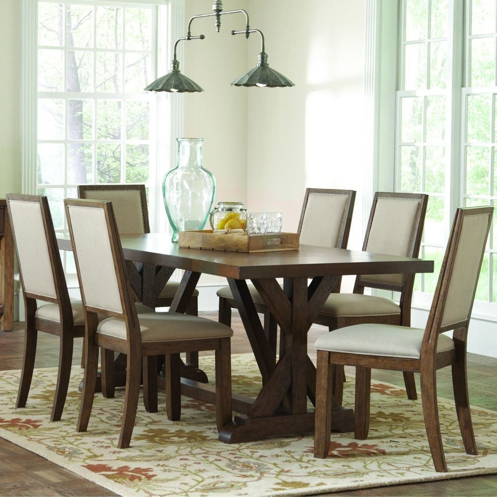 Craftsman 7 Piece Rectangle Extension Dining Sets With Uph Side Chairs Within Well Liked The Beige Upholstery And Natural Wood Finish On This Danville Dining (View 20 of 25)