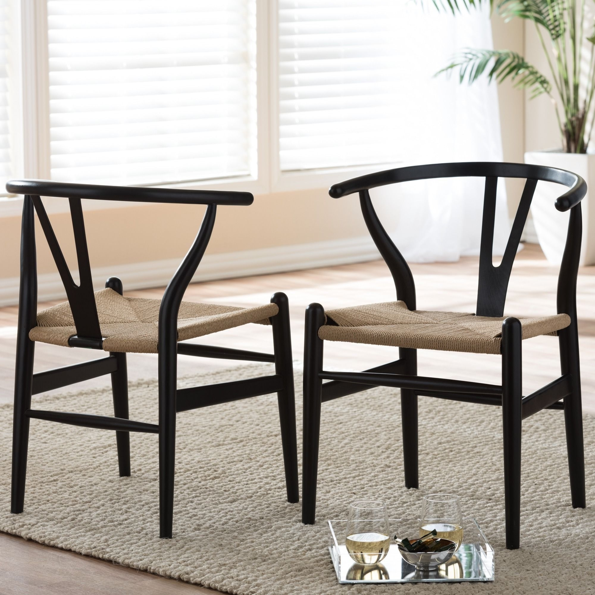 Current Caira Black 7 Piece Dining Sets With Upholstered Side Chairs For Baxton Studio Wishbone Modern Black Wood Dining Chair With Light (Gallery 25 of 25)