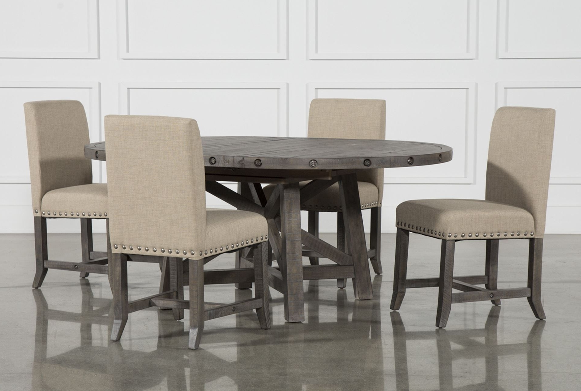 Current Jaxon Grey 5 Piece Round Extension Dining Set W/upholstered Chairs Intended For Combs 7 Piece Dining Sets With  Mindy Slipcovered Chairs (View 6 of 25)