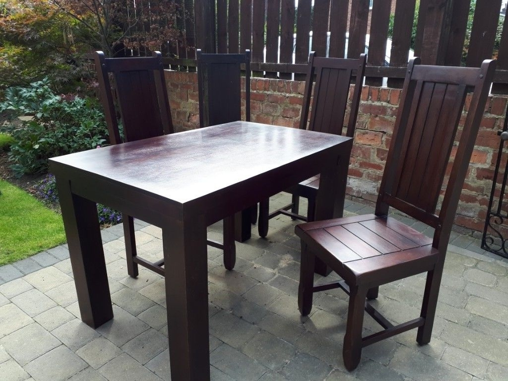 Dark Wood Dining Tables inside Fashionable Solid Dark Wood Dining Table And 4 Chairs