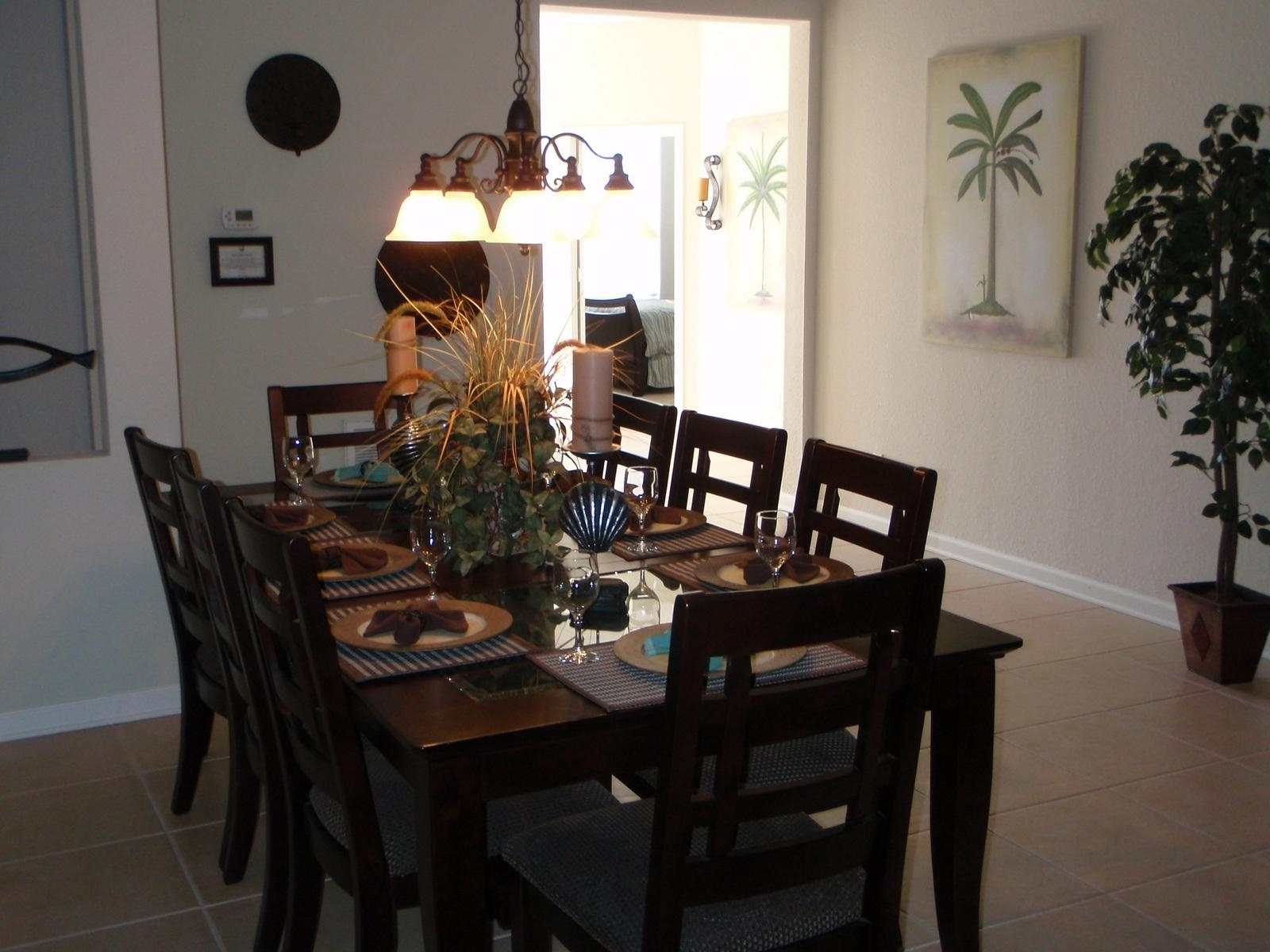 Dining Tables For Eight in Well-liked 8 Seater Dining Table With Rough Tile Flooring And Chandelier Over