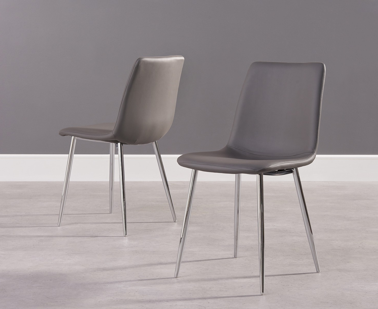 Ellisa Grey Faux Leather Dining Chair With Chrome Legs (Pair) regarding Most Up-to-Date Grey Leather Dining Chairs
