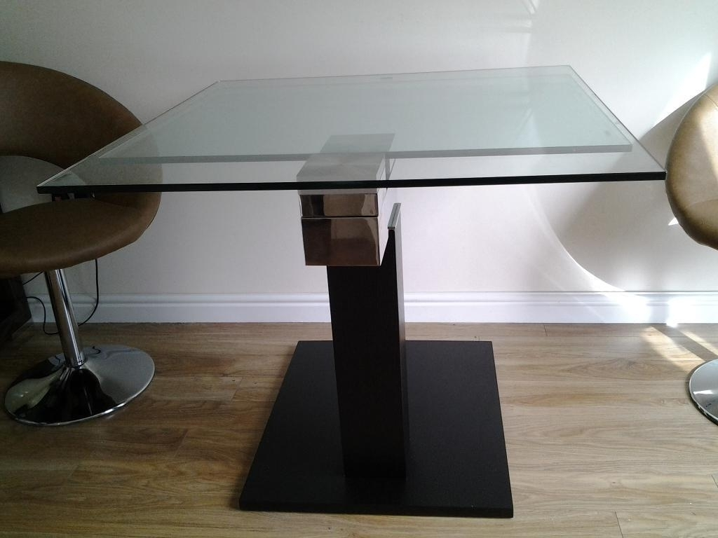 Enzo Extending Glass Dining Table With Black And Chrome Base within Most Recently Released Extending Glass Dining Tables