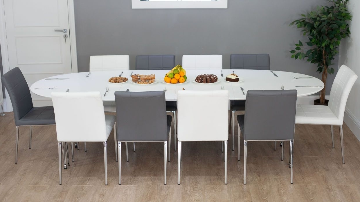 Famous Stylish White Oval Double Extending Dining Table And Faux Leather Regarding White Oval Extending Dining Tables (View 6 of 25)