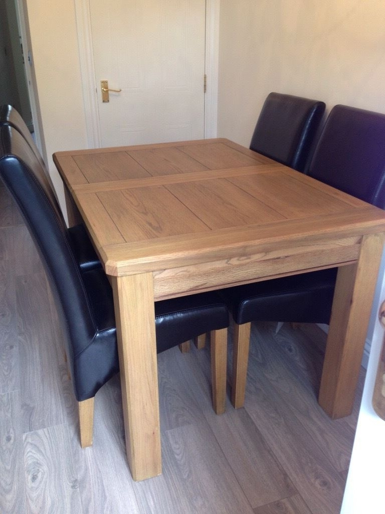 Fashionable Extending Solid Oak Dining Tables Regarding Harvey's Extending Solid Oak Dining Table And 6 Black/brown Leather (View 15 of 25)