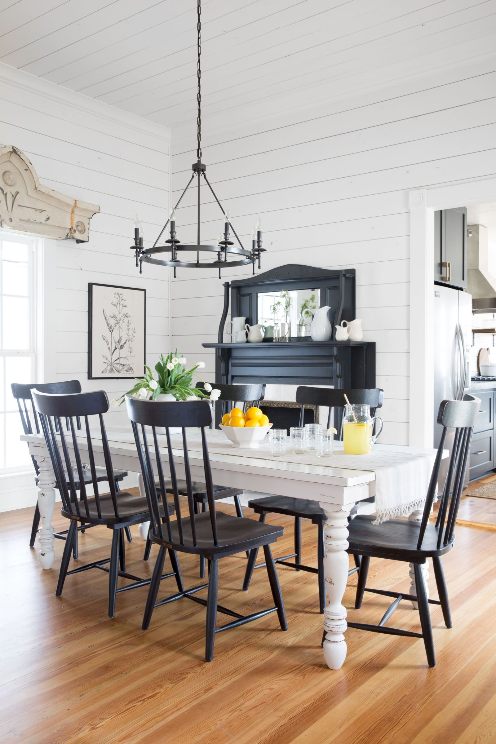 Fashionable Magnolia Home Breakfast Round Black Dining Tables Intended For Take A Tour Of Chip And Joanna Gaines' Magnolia House B&b (View 4 of 25)