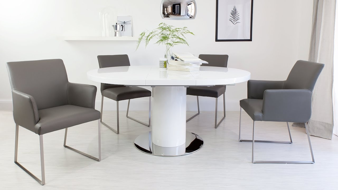 Fashionable Round White Gloss Extending Dining Table And Real Leather Dining Within Round Extendable Dining Tables And Chairs (View 10 of 25)