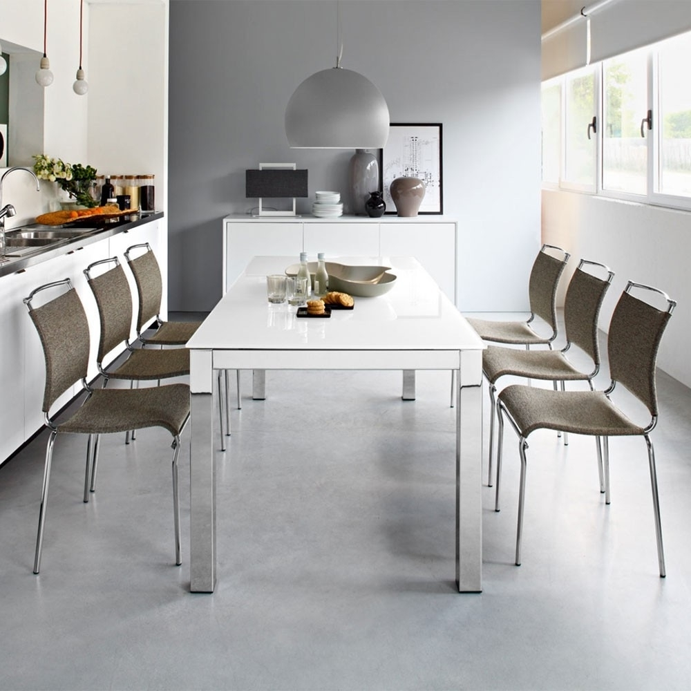 Glass Folding Dining Tables pertaining to Famous Aprilia Extending Glass Dining Table