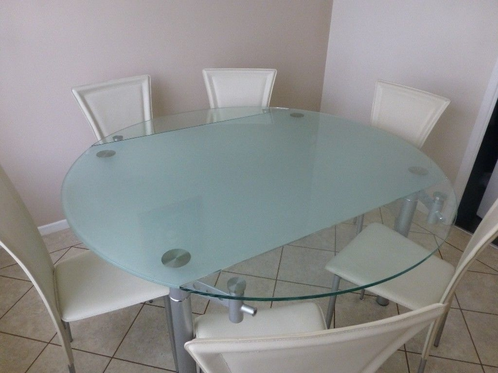 Glass Round Extending Dining Tables Regarding Well Known Modern Round Glass Extending Dining Table & 6 Cream Leather Effect (View 13 of 25)