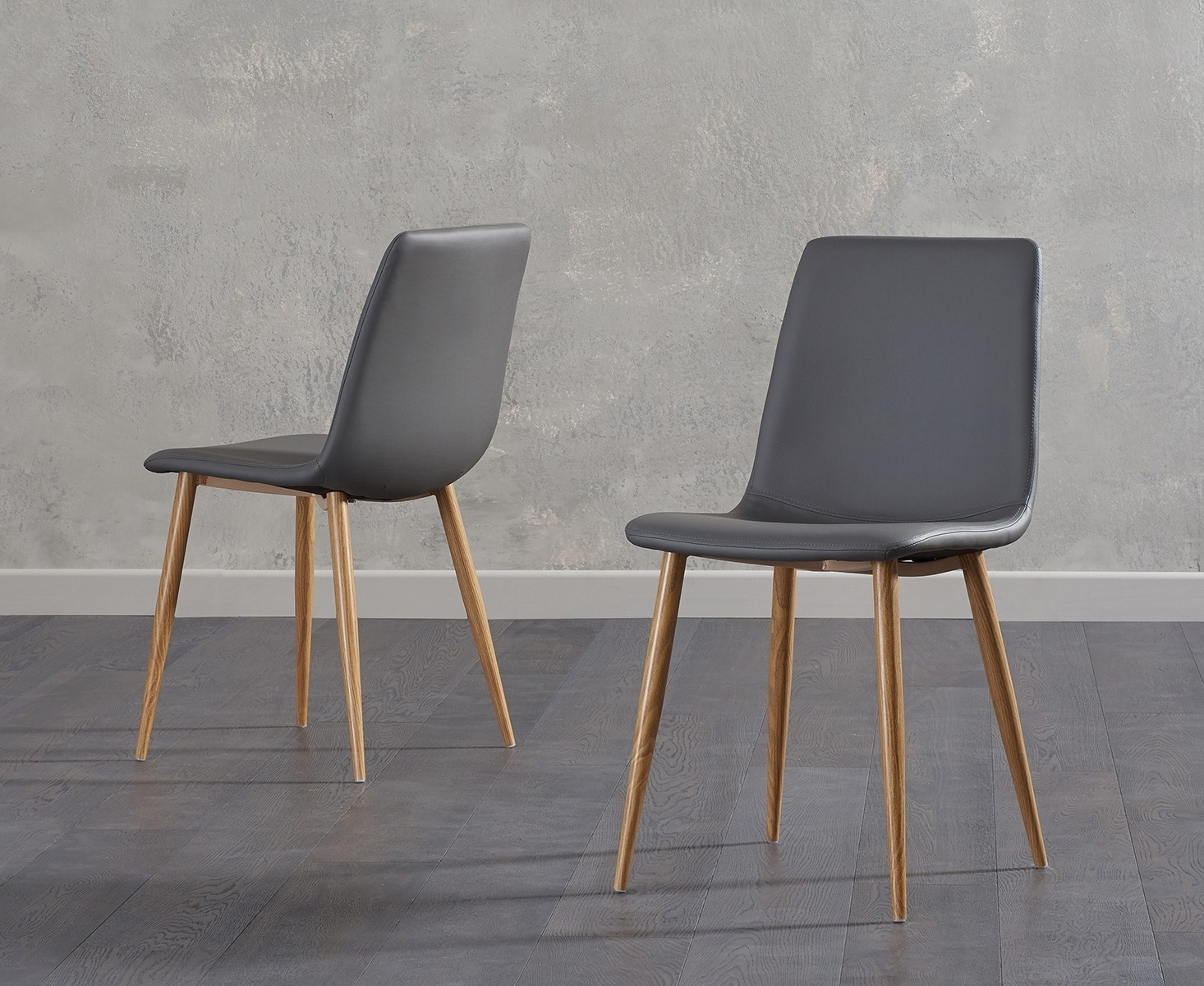 Grey Leather Dining Chairs intended for Best and Newest Ellisa Grey Faux Leather Dining Chair With Wooden Legs (Pair)