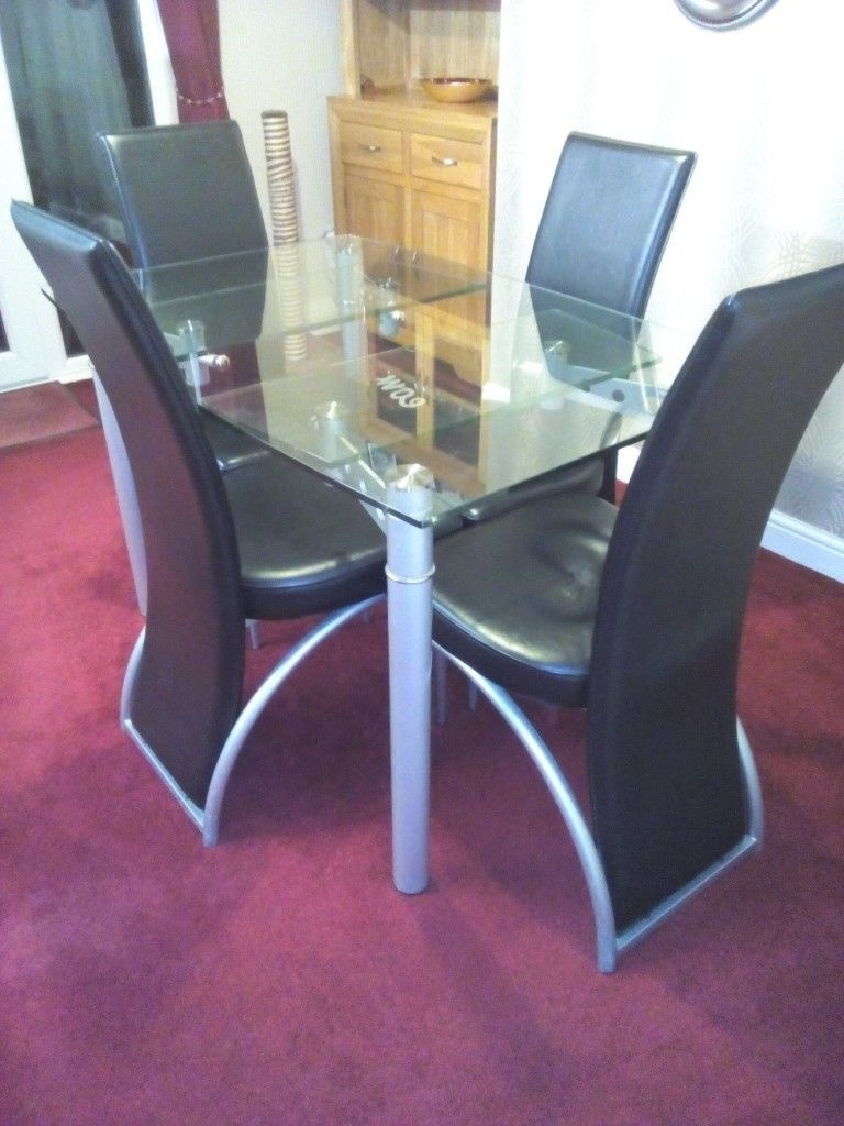 In Seacroft, West In Extending Glass Dining Tables And 8 Chairs (View 23 of 25)