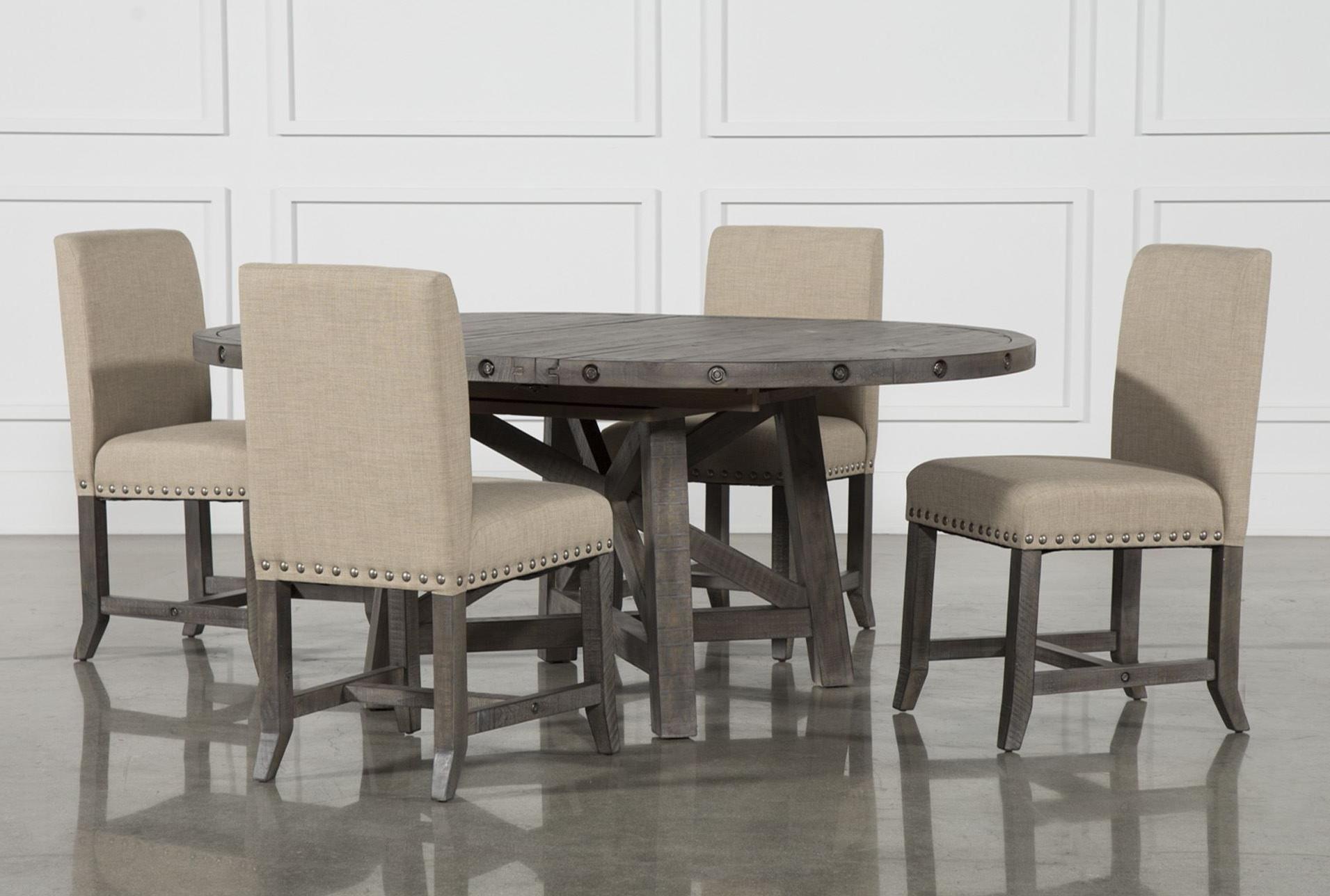 Jaxon Grey 5 Piece Round Extension Dining Set W/upholstered Chairs regarding 2017 Caden 5 Piece Round Dining Sets