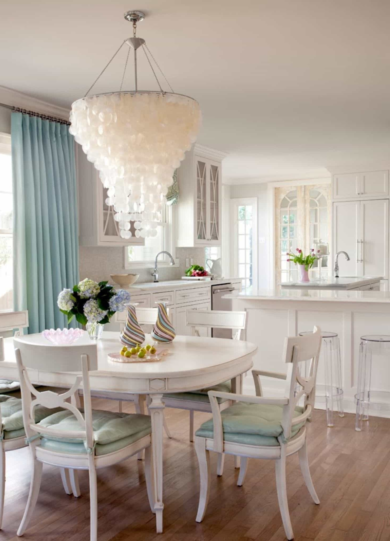 Lamp Over Dining Tables With Newest Large Capiz Shell Chandelier Over White Dining Table And Chairs In (View 16 of 25)