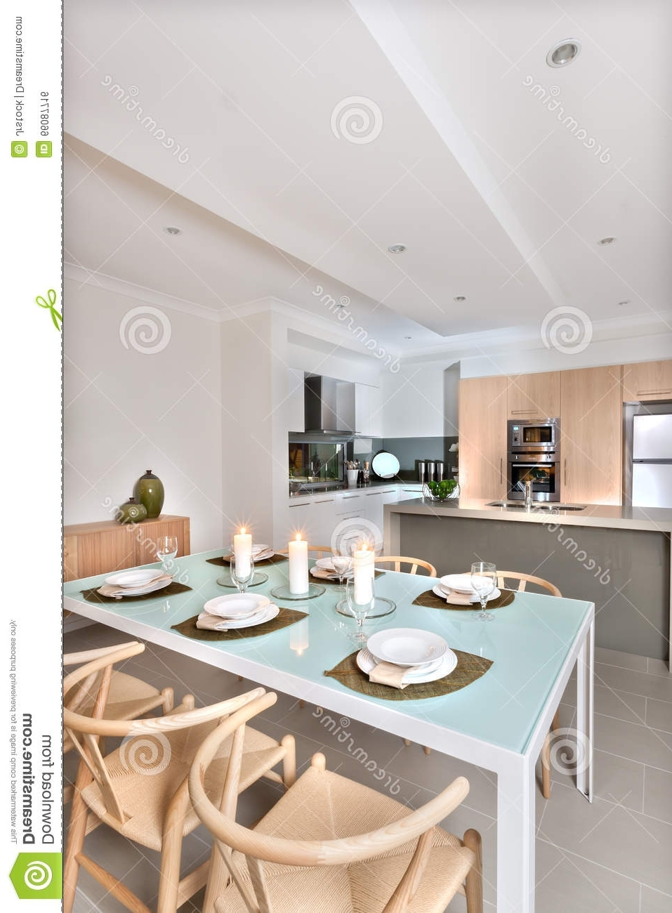 Most Current Modern Dining Room Setup With Candles Flashing In Front Of The Throughout Shiny White Dining Tables (View 5 of 25)