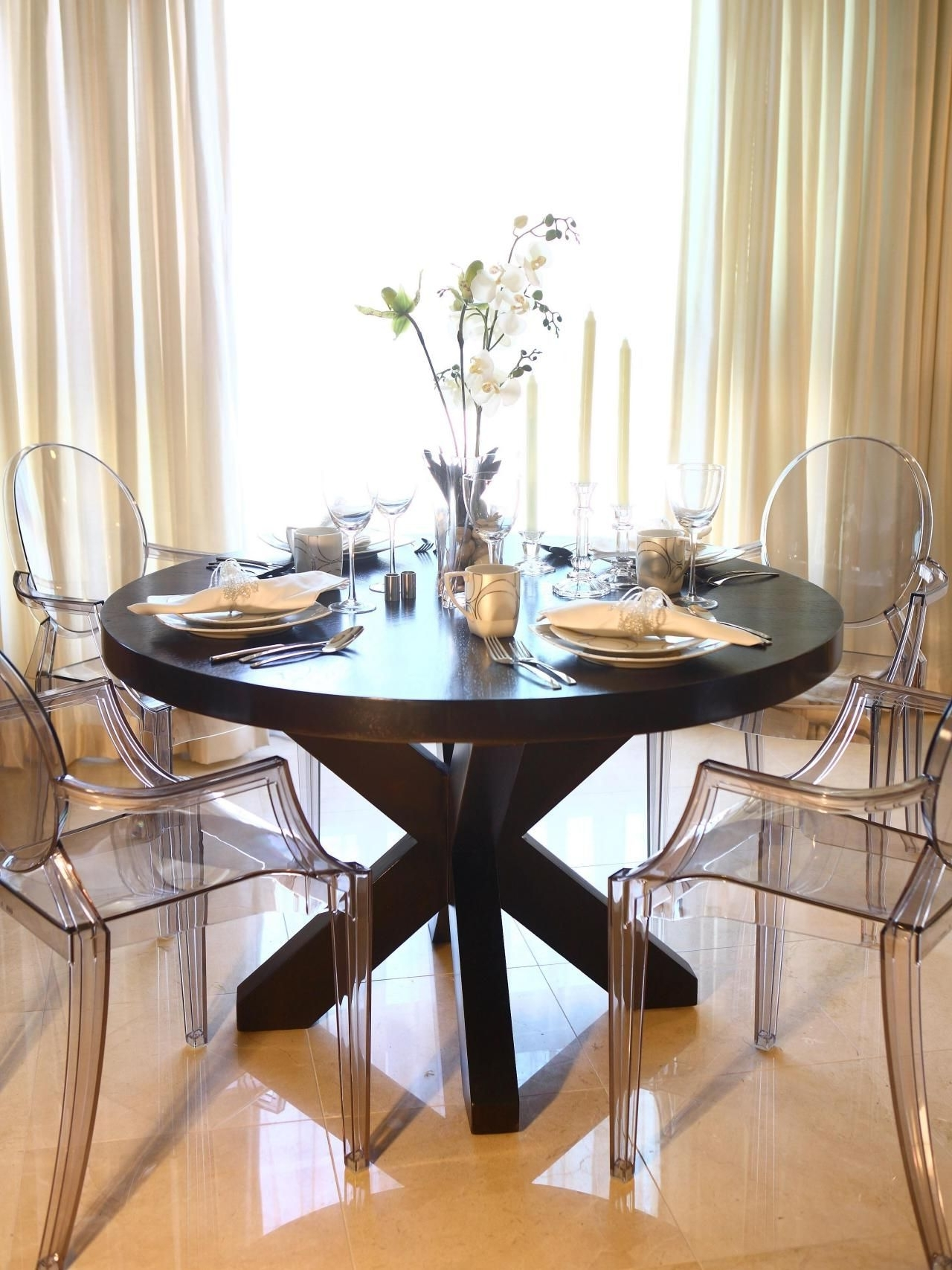 Most Current This Elegant Dining Room Features A Large Round Wood Dining Table For Acrylic Round Dining Tables (View 3 of 25)