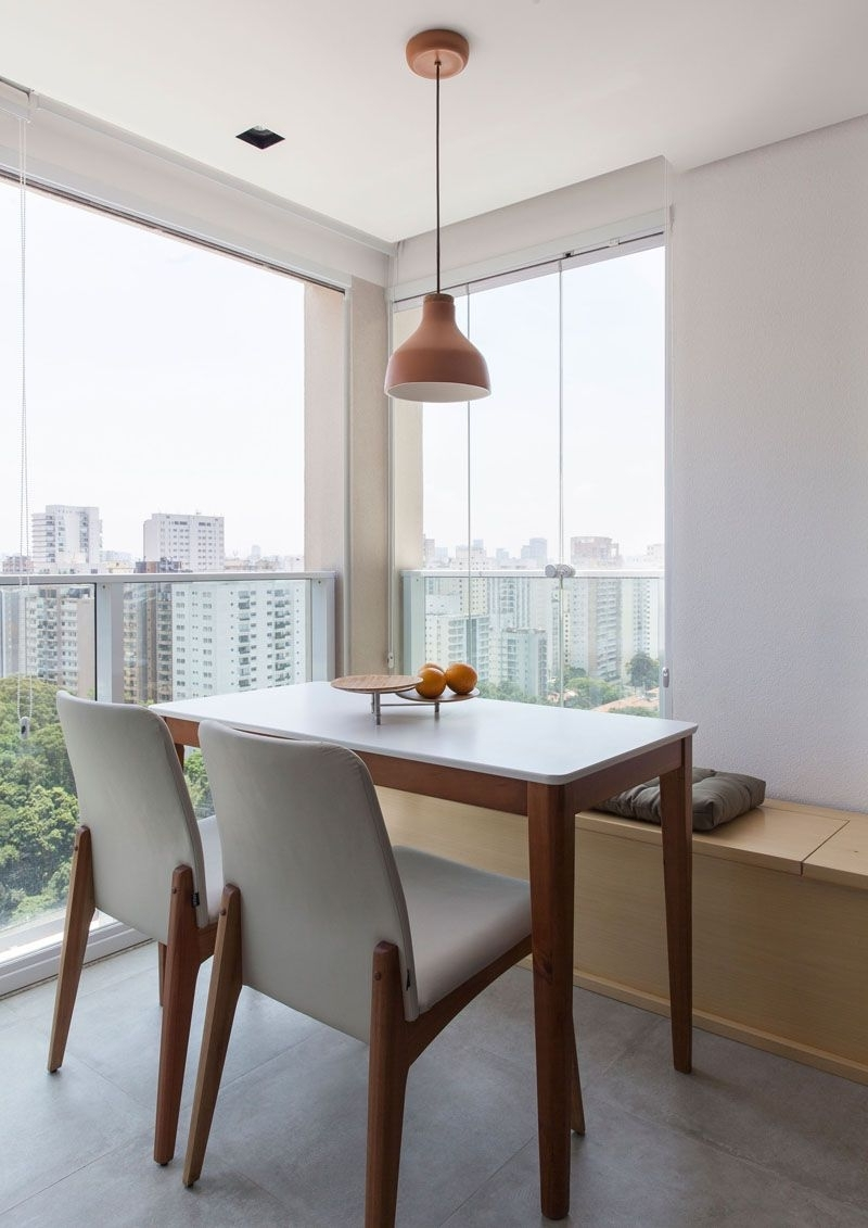 Most Current This Small Apartment In Brazil Has A Bedroom Hidden Behind A Sliding In Norwood 9 Piece Rectangle Extension Dining Sets (View 11 of 25)