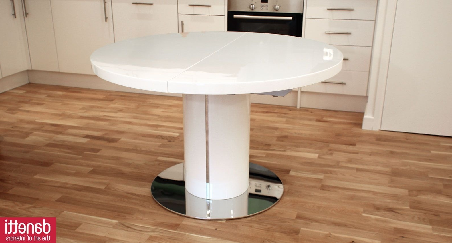 Most Popular Curva Round White Gloss Extending Dining Table (View 11 of 25)
