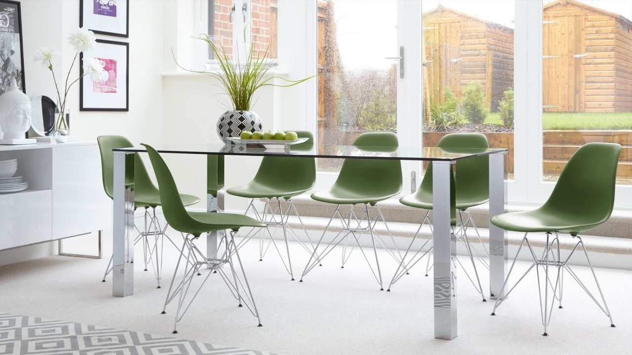 Most Recent Glass Dining Tables 6 Chairs Inside Contemporary Glass 6 Seater Dining Table And Eames Dining Chairs (View 9 of 25)