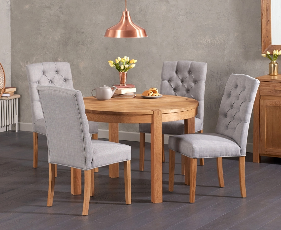Most Recently Released Candice Ii Round Dining Tables Inside Verona 110Cm Solid Oak Round Table With Candice Fabric Chairs (View 14 of 25)