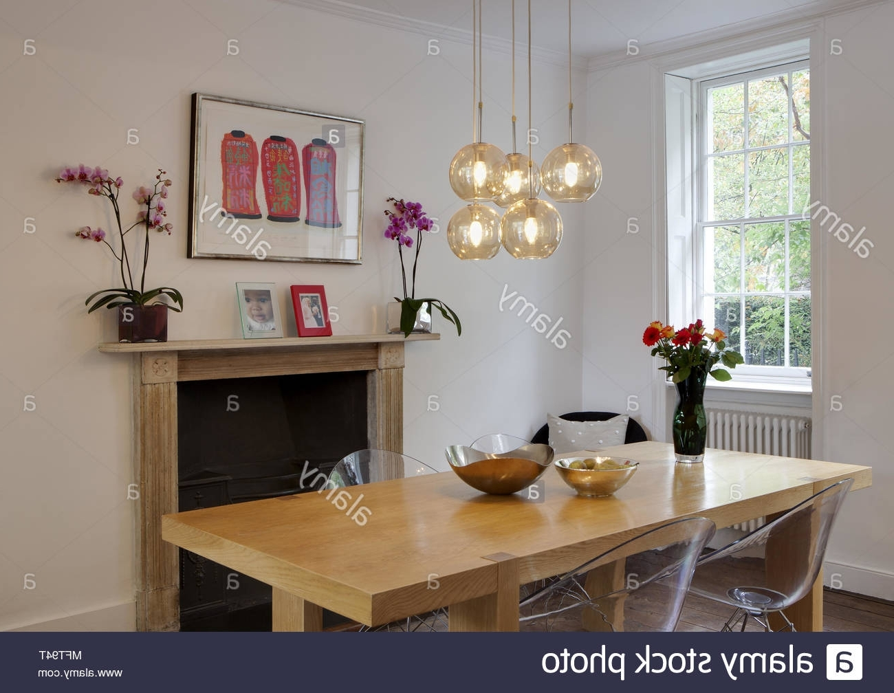 Pendant Lights Above Wooden Dining Table With Eames Transparent Within Most Current Dining Tables Lights (Gallery 19 of 25)