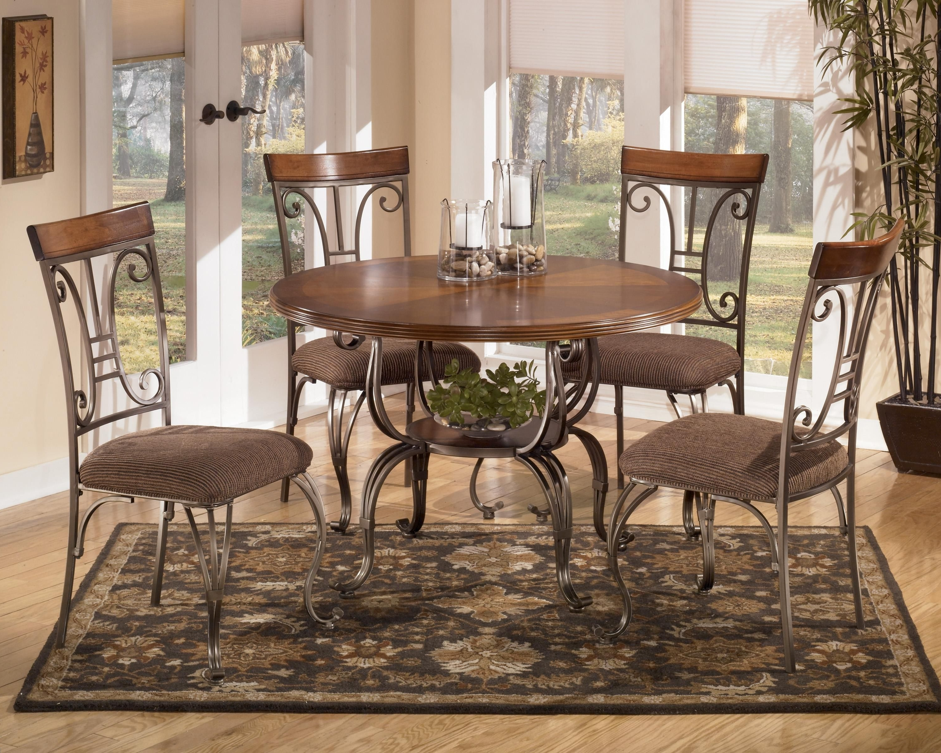 Plentywood 5 Piece Round Dining Table Setsignature Design Within Current Craftsman 7 Piece Rectangular Extension Dining Sets With Arm & Uph Side Chairs (View 25 of 25)