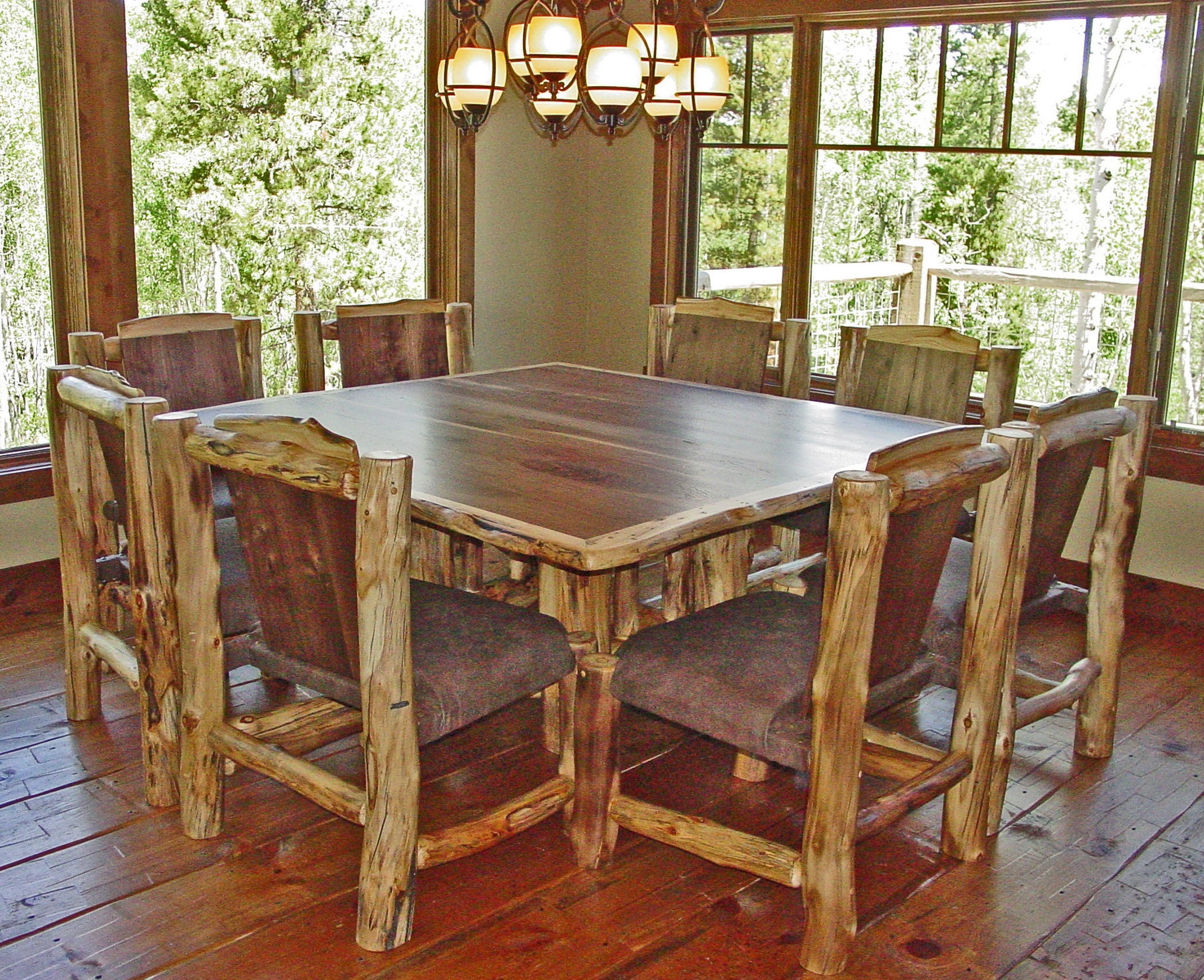 Popular Dining Tables For Eight Throughout Rustic Log Square Dining Table Below Artistic Pendant Lighting And (View 17 of 25)