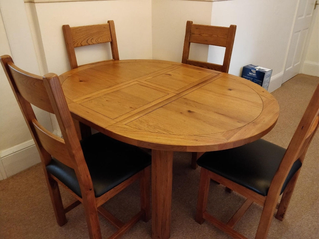 Round Extendable Dining Tables And Chairs Pertaining To 2018 Toulouse Oak Round Extendable Dining Table & 4 Chairs From Harveys (View 13 of 25)
